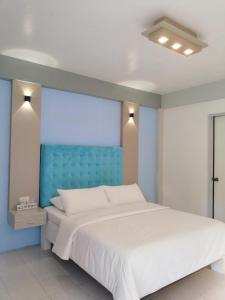 A bed or beds in a room at Casa Pilar Beach Resort