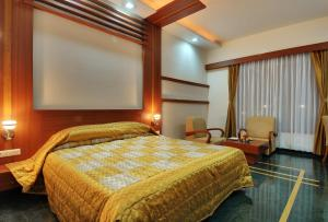A bed or beds in a room at Inder Residency Udaipur