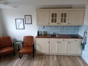 Een keuken of kitchenette bij De Welvaart - Hotel Restaurant