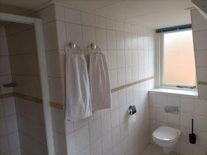 Een badkamer bij De Welvaart - Hotel Restaurant