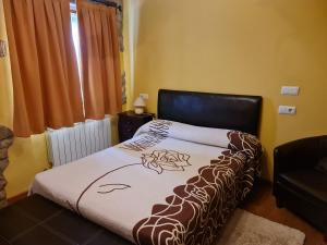 A bed or beds in a room at POSADA LAS MOZAS