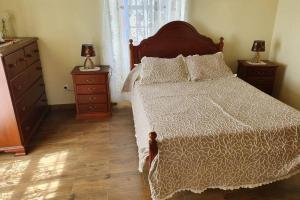 Cama ou camas em um quarto em Casa Eira Alta