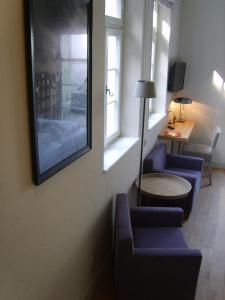 Ein Sitzbereich in der Unterkunft Hotel Schnookeloch