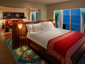 A bed or beds in a room at Faena Hotel Miami Beach