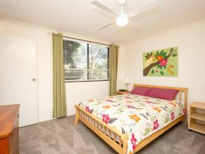 A bed or beds in a room at Apartment with Inground Pool