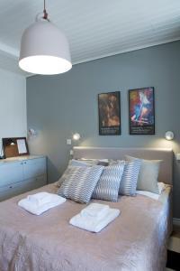 Vuode tai vuoteita majoituspaikassa Hotel Amandis