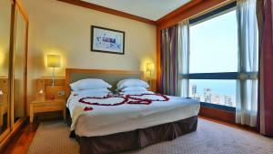 A bed or beds in a room at Crowne Plaza Hamra Beirut, an IHG Hotel