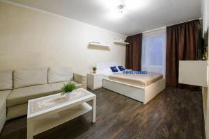 Кровать или кровати в номере Apartment Hanaka on Bratskaya 23