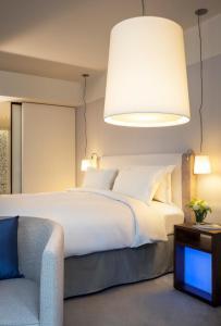 Cama ou camas em um quarto em Sofitel Paris Arc De Triomphe