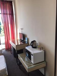 Телевизор и/или развлекательный центр в Joy Apartments