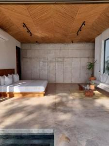 A bed or beds in a room at Mint Santa Teresa - Adults only