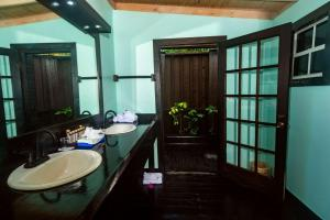 A bathroom at Cocos Hotel Antigua - All Inclusive - Adults Only