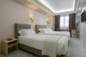 A bed or beds in a room at Athens Starlight Hotel