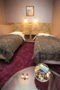 Кровать или кровати в номере Отель Кастелло
