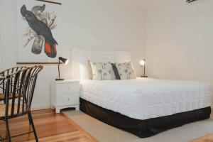 A bed or beds in a room at The Arabella North Coast