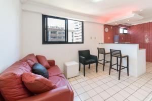 A seating area at Boa Viagem Flat