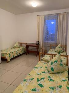 Кровать или кровати в номере Гостиница Ак Керман