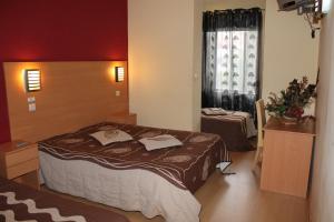 Uma cama ou camas num quarto em Guest House Estrela