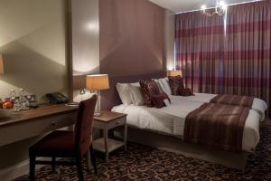 A bed or beds in a room at Halifax Hall