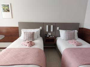 A bed or beds in a room at Bugan Recife Hotel by Atlantica