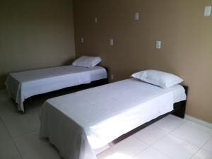 A bed or beds in a room at Amazônia Palacce Hotel
