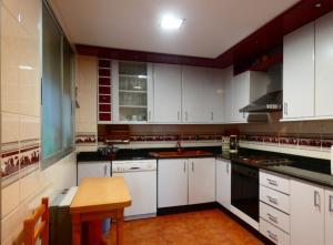 Una cocina o zona de cocina en Apartamento con encanto bien equipado