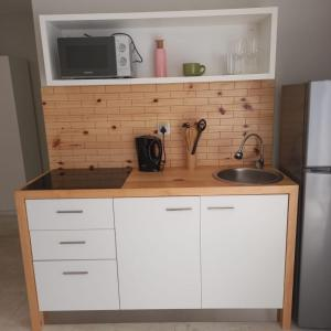 A kitchen or kitchenette at Joli Guesthouse