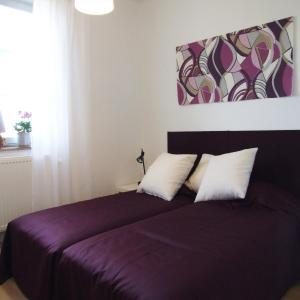 Säng eller sängar i ett rum på Villa Nore