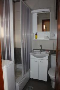 A bathroom at Apartments Milena