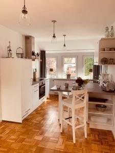Kuchyň nebo kuchyňský kout v ubytování mitten im dorf