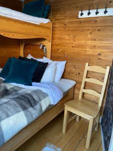 A bed or beds in a room at Joängets Fjällgård