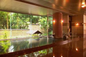 The swimming pool at or near Unazuki Kokusai Hotel