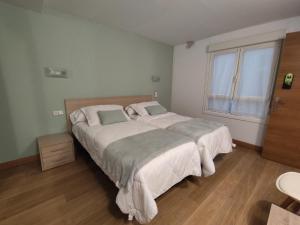 Cama o camas de una habitación en Pension Joakina