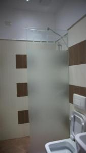 A bathroom at Hotel Vila Kerciku