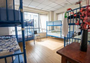 A bunk bed or bunk beds in a room at The Apache Hostel
