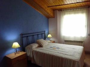 Cama o camas de una habitación en Turisme Rural El Janpere