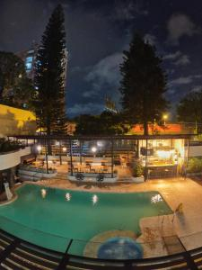 The swimming pool at or near Medellín Vibes Hostel