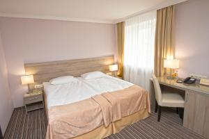 A bed or beds in a room at Optima Kherson