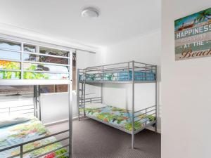 A bunk bed or bunk beds in a room at Hit The Beach