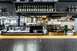 A kitchen or kitchenette at Astrus Hotel Moscow