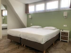 Een bed of bedden in een kamer bij Les Maisons Domburg