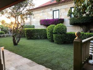 A garden outside Hotel Playa de Vigo