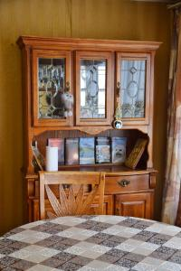 """A television and/or entertainment center at """"AMTO"""" Guest House"""
