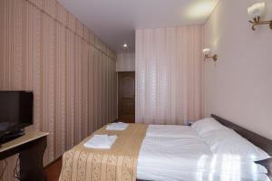 Кровать или кровати в номере Гостевой Дом Просперус