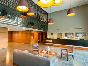 El vestíbulo o zona de recepción de City Express Plus Cali