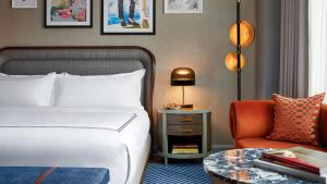 A bed or beds in a room at The Opus, Westchester, Autograph Collection