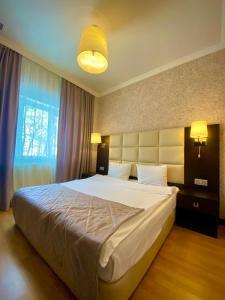 Cama ou camas em um quarto em Altiagac Cennet Bagi