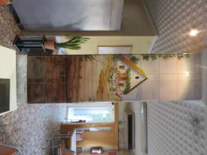 A kitchen or kitchenette at Hotel Alain
