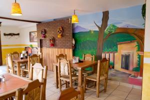 A restaurant or other place to eat at Hacienda los Algodones