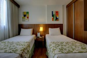 A bed or beds in a room at Nobile Suites Monumental